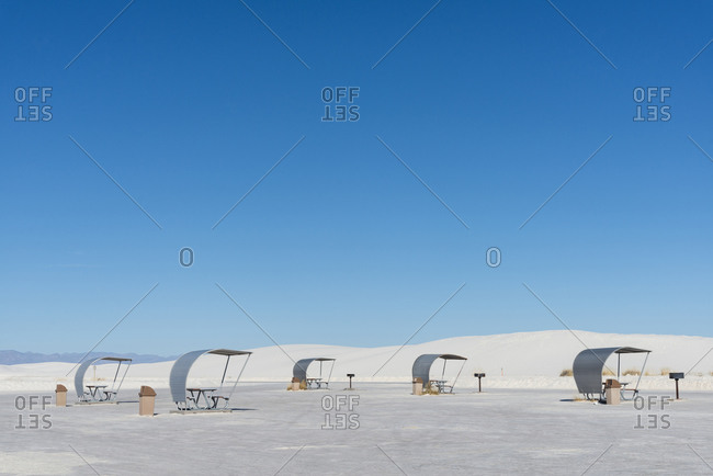 Covered picnic tables at a rest stop in White Sands National Park near Alamogordo, New Mexico