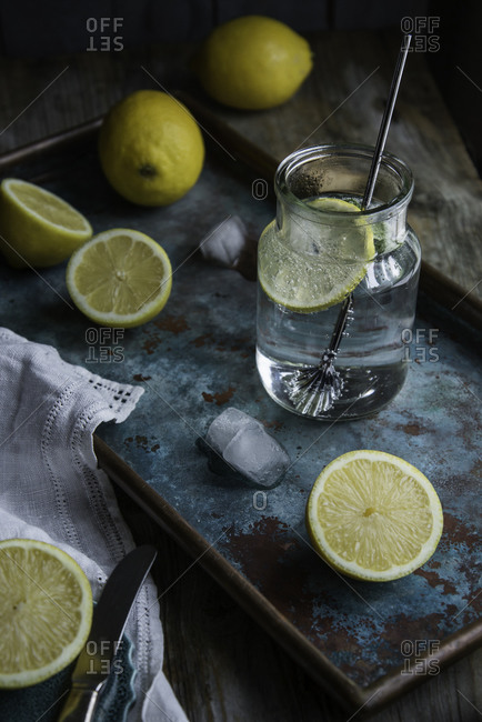 Lemon infused water on a rustic tray