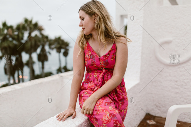 Woman sitting on her balcony overlooking the beach in Baja California, Mexico
