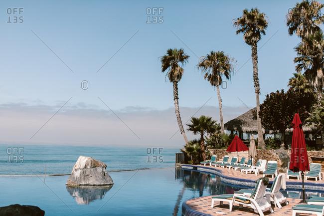 Ensenada, Baja California, Mexico - August 17, 2019: Mexican resort infinity pool overlooking the ocean in Mexico