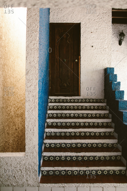 Tile lined stair on stucco building in Mexico