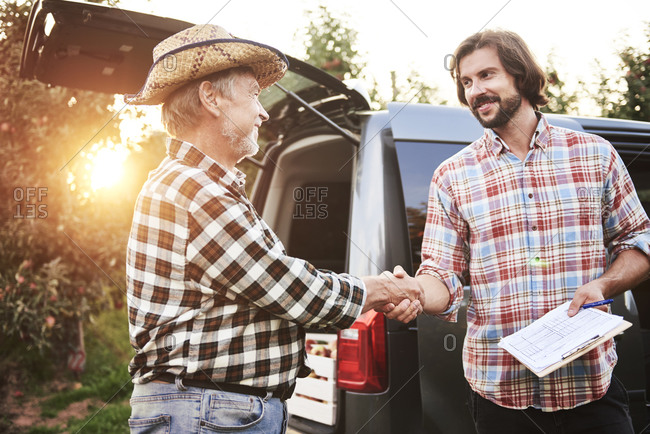 Fruit growers agreeing on a deal- shaking hands