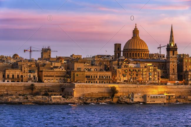 Malta- Valletta- City skyline at sunset and Marsamxett Harbor