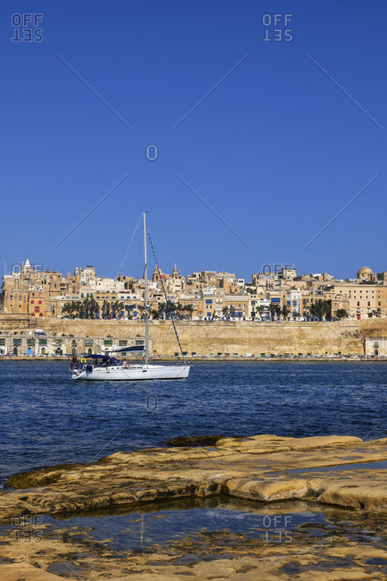 Malta- Valletta- View of city from Birgu side with sailboat on Grand Harbor