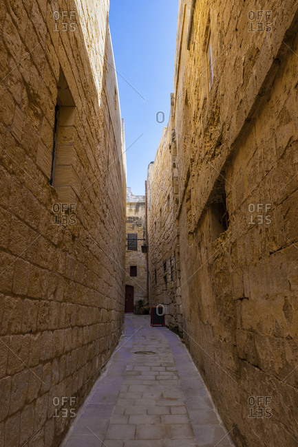 Malta- Medina- Narrow cobbled street and medieval stone walls in old capital - Silent City
