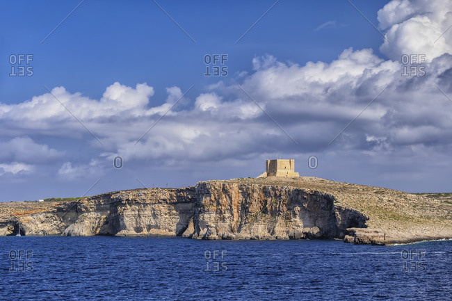 Malta- Comino- Clouds over coastal cliffs and Saint Marys Tower