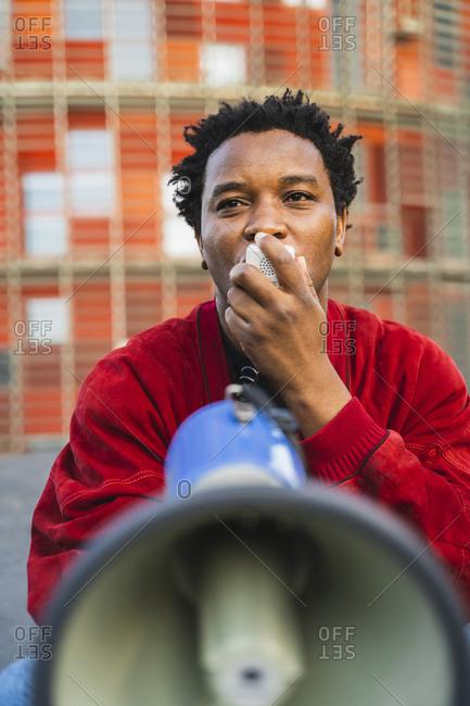 Portrait of mature man using megaphone- Barcelona- Spain