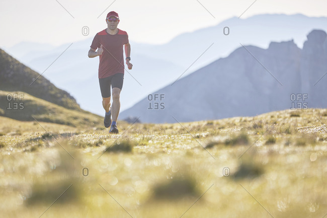 Trail runner running in the mountains