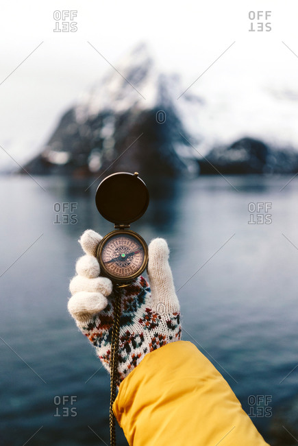 Close-up of tourist using a compass at Hamnoy- Lofoten- Norway