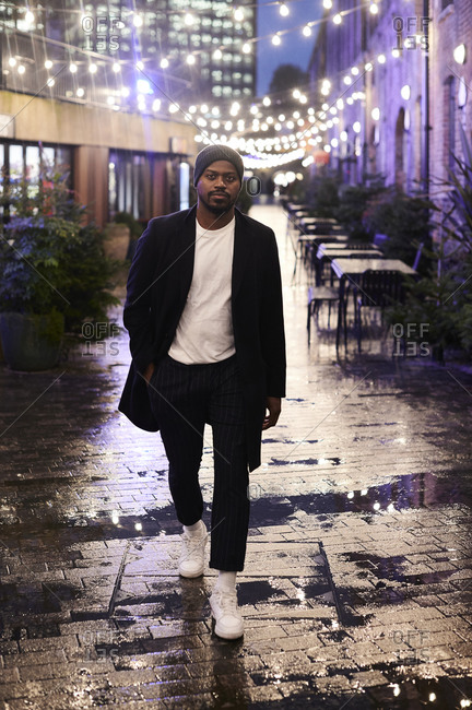 Portrait of stylish man in the city at night- London- UK
