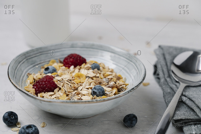 Bowl of granola with blueberries and raspberries