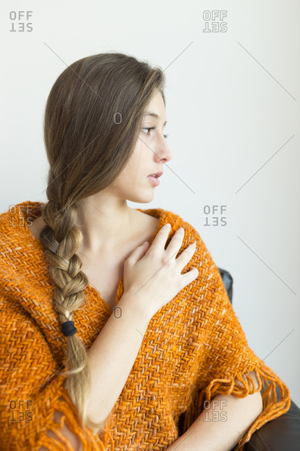 Portrait of young woman with orange shawl