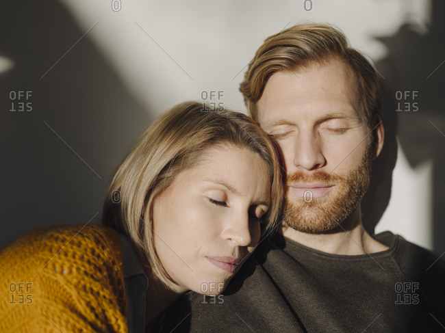 Portrait of relaxed couple in sunlight
