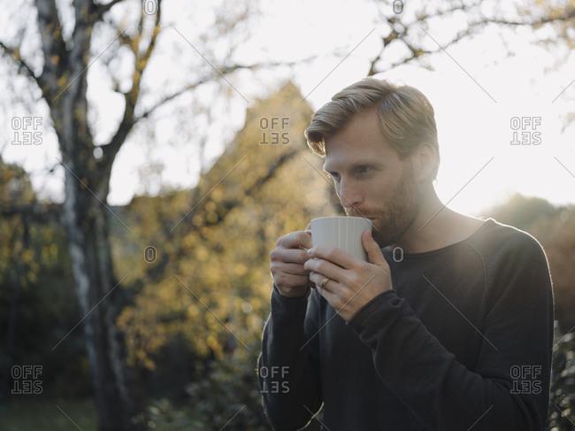 Man having a coffee break in garden
