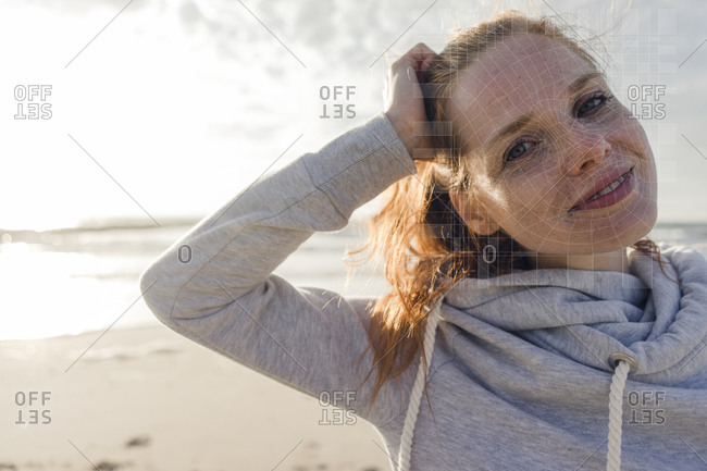 Portrait of smiling woman on the beach with grid over his face
