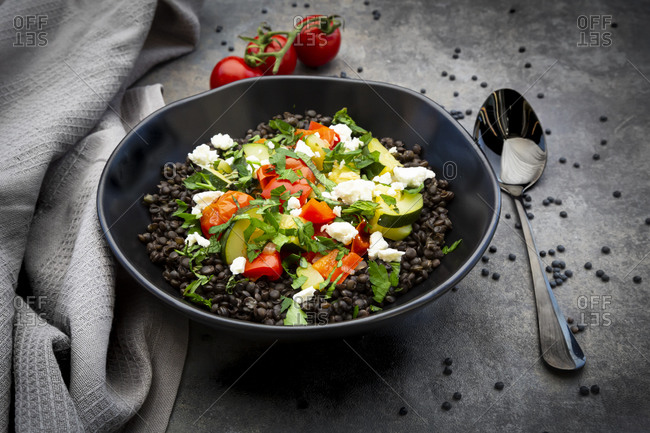 Beluga lentils with tomatoes- peppers- zucchini- feta- mint and parsley