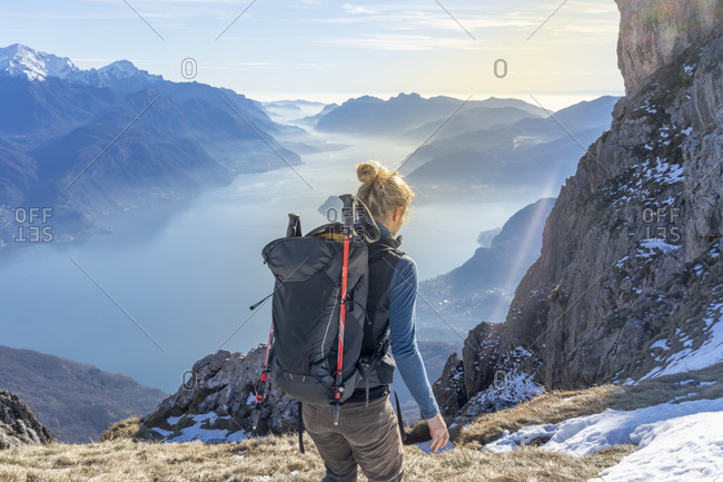 Woman hiking in the mountains at Lake Como- Italy