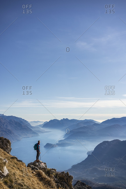 Hiker standing on mountain- looking at Lake Como- Italy