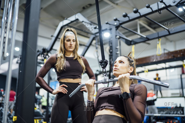 Twin sisters exercising in gym