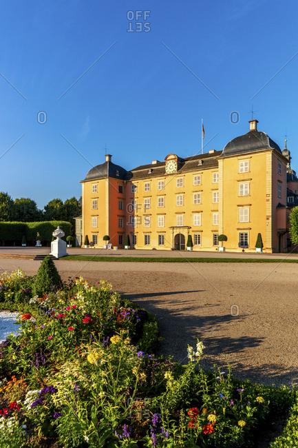 Germany- Baden-Wurttemberg- Schwetzingen Palace with flowerbed in foreground