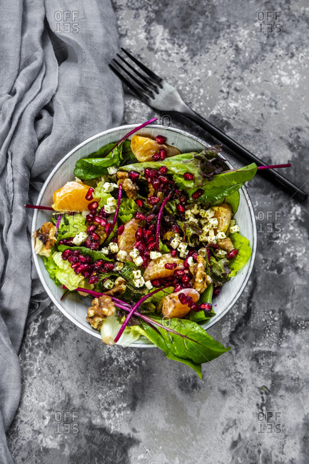 Winter salad with lettuce- tangerines- walnuts- feta and pomegranate seeds