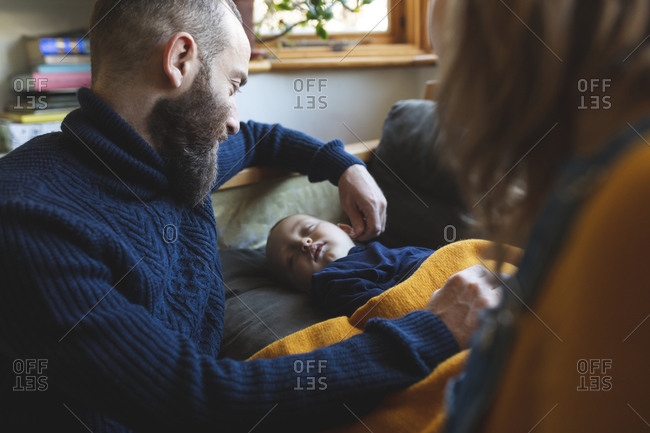 Affectionate family with little son sleeping on the sofa