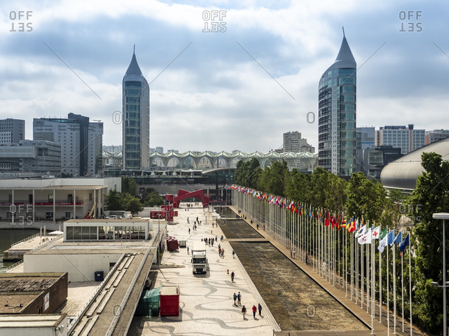 July 8, 2017: Portugal- Lisbon- Row of national flags in Parque das Nacoes with Torre Sao Gabriel and Torre Sao Rafael in background