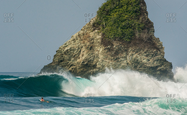 Surfer chasing the swell in Costa Rica