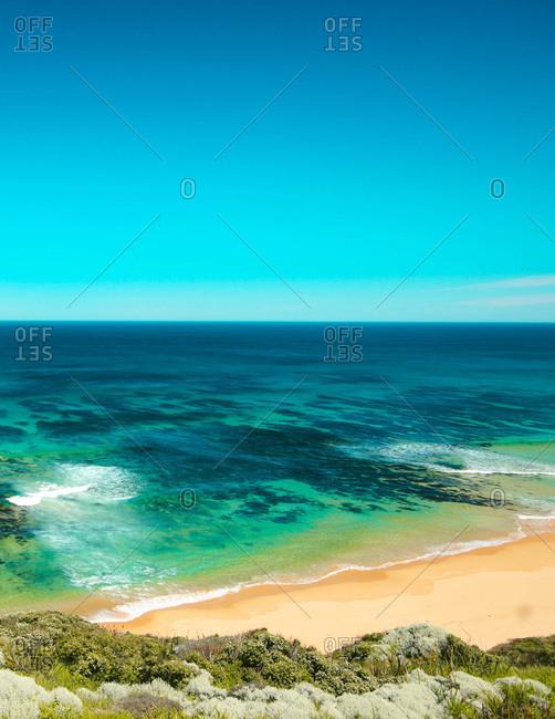 Ocean reef on Great Ocean Road, Australia during bright summers day