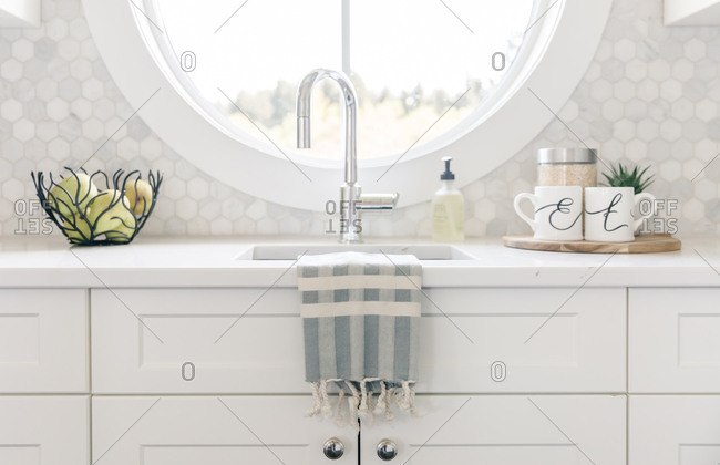 Tea towel on sink with mugs at morning butlers pantry