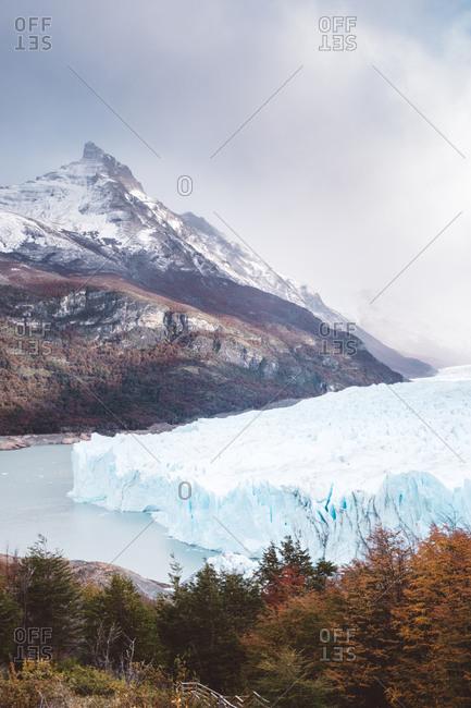 Calm sea near mountain and glacier