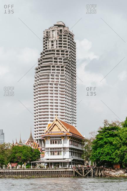 Thailand, Bangkok - April 28, 2009: Apartment building at the banks of Chao Phraya River