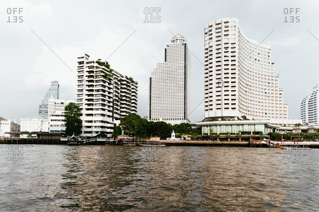 Thailand, Bangkok - April 28, 2009: Buildings at the banks of Chao Phraya River