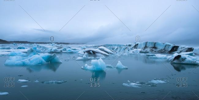 Icebergs on Lake Jokulsarlon the Vatnajokull National Park with fog