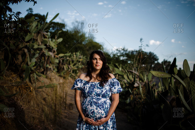 Pregnant Mid Thirties Woman Posing in Cactus Garden