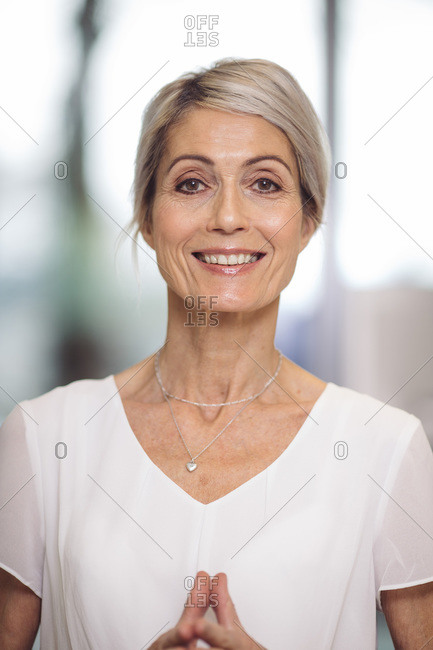 Portrait of beautiful 67 year old smiling woman