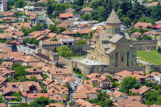 Georgia, Mtskheta-Mtianeti, Mtskheta - June 4, 2019: High-angle view of Svetitskhoveli Cathedral and Mtskheta historic center