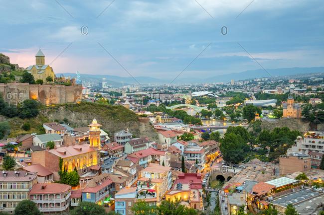 Georgia, Tbilisi, Tbilisi - June 5, 2019: Narikala Fortress and historic buildings in Abanotubani bath district