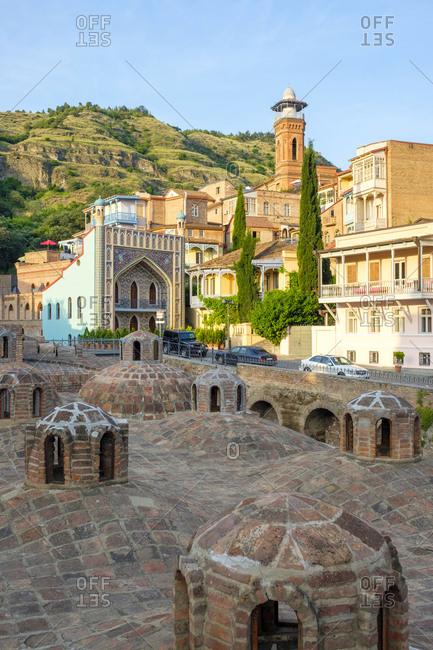 Georgia, Tbilisi, Tbilisi - June 6, 2019: Sulphur baths and historic buildings in Abanotubani bath district