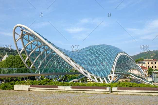 Georgia, Tbilisi, Tbilisi - June 6, 2019: Bridge of Peace over the Kura (Mtkvari) River