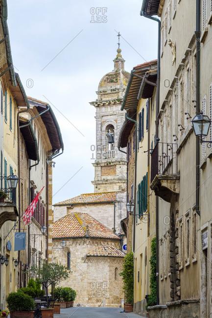 Italy, Tuscany, San Quirico d'Orcia - May 13, 2019: Collegiata dei Santi Quirico e Giulitta church and buildings