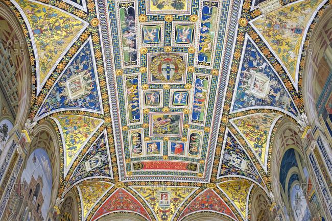 Italy, Tuscany, Siena - May 16, 2019: Ceiling of Piccolomini Library, Duomo di Siena (Siena Cathedral)