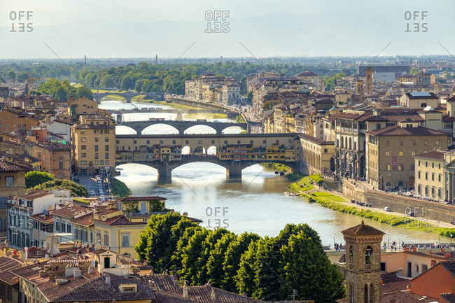 Italy, Tuscany, Florence - May 16, 2019: Ponte Vecchio, Arno river and buildings in old town