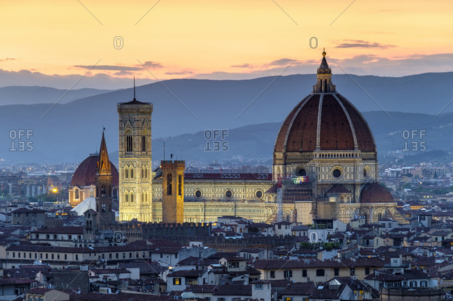 Italy, Tuscany, Florence - May 16, 2019: Florence Cathedral and buildings in old town at sunset