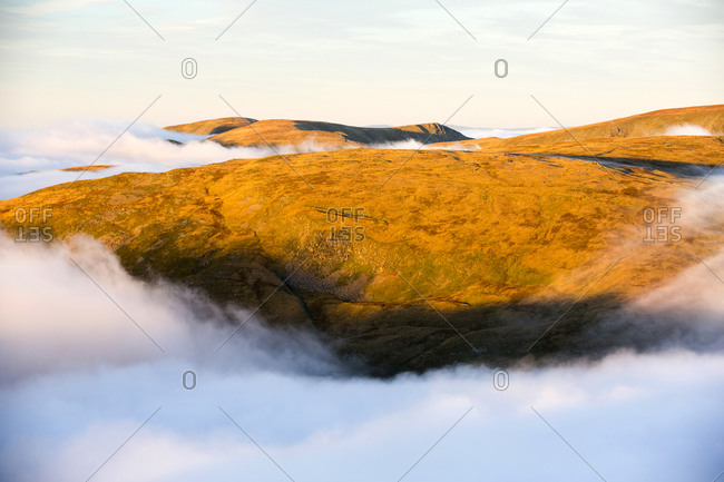 Looking towards High Street from Red Screes in the Lake District, Cumbria, UK, with valley cloud caused by a temperature inversion.