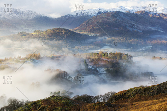 Looking down into the Langdale Valley above valley mist formed by a temperature inversion on Loughrigg, near Ambleside in the Lake District National Park.