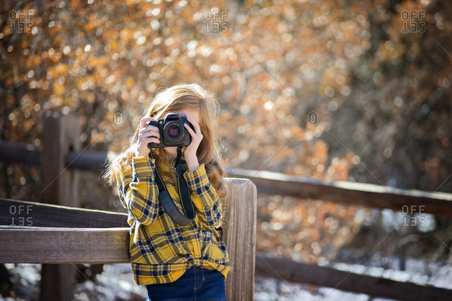 Young Girl Hiking and Taking Pictures in the Mountains