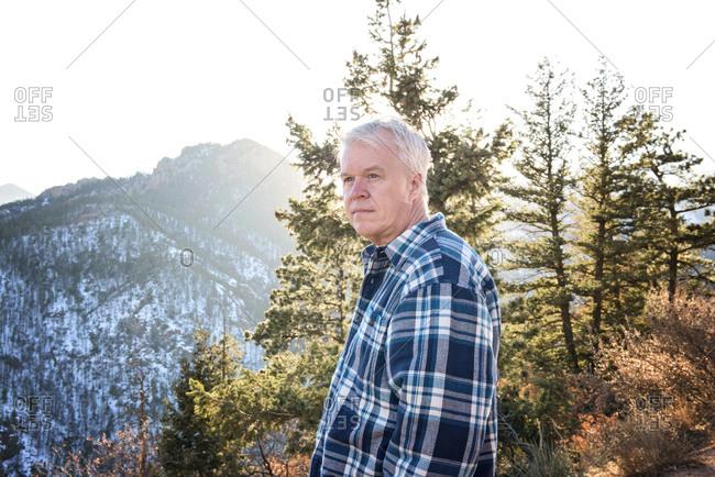 Senior Man Looking Into Distance on a Mountain Walk
