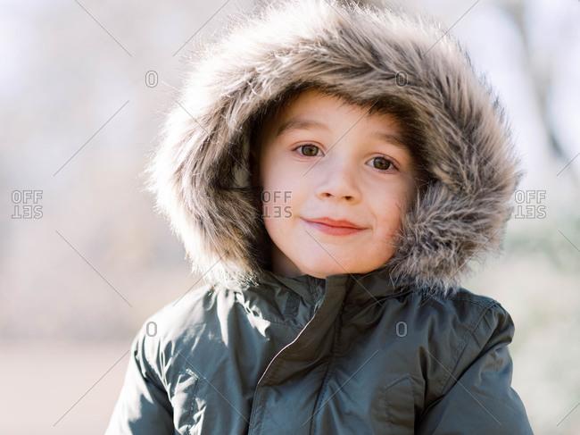 Little boy in winter parker.