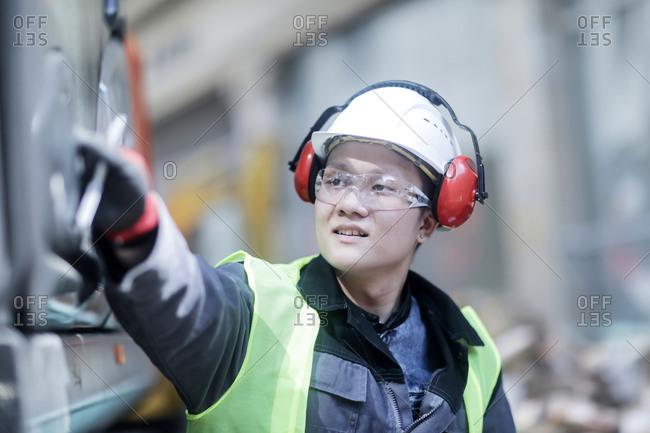 Civil engineer with helmet in a street  building site